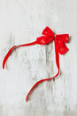 Festive red bow with a ribbon on a white wooden background Royalty Free Stock Photos