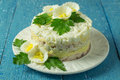 Festive salad multilayer chicken with egg and cheese on a blue wooden background Royalty Free Stock Photography