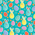 Festive seamless pattern with colored eggs and Easter bunnies. Vector illustration. Usable for design, packaging, wallpaper, texti Royalty Free Stock Photo