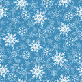 Festive seamless pattern with ornate snowflakes Royalty Free Stock Photo