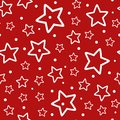 Festive seamless pattern. Repeated outlines of white stars and polka dots on red background.