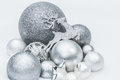 Festive silver grey shiny Christmas ornaments with Santa's ninth reindeer at natural snow background Royalty Free Stock Photo