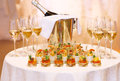 Festive table served with appetizers and champagne in glasses celebration wedding feast concept Royalty Free Stock Photography