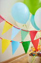 Festive table setting for birthday on celebratory decorations Stock Images