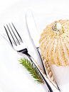 Festive table setting with christmas ornaments and copy space f for text fir tree branch golden ball on white plate Royalty Free Stock Image