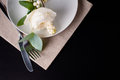 Festive table setting with floral decoration white roses leaves and berries on a black background Stock Images