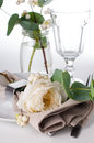 Festive table setting with floral decoration white roses leaves and berries on a white background Stock Images