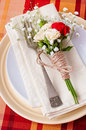 Festive table setting with flowers and vintage crockery Royalty Free Stock Photo