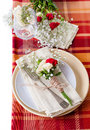 Festive table setting with flowers and vintage crockery Royalty Free Stock Photos