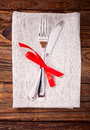Festive table setting with fork knife and red ribbon top view Royalty Free Stock Image