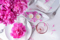 Festive table setting with pink peonies bright candles and vintage cutlery Stock Image