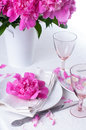 Festive table setting with pink peonies bright candles and vintage cutlery Royalty Free Stock Images