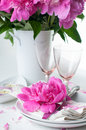 Festive table setting with pink peonies bright candles and vintage cutlery Royalty Free Stock Photo