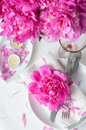 Festive table setting with pink peonies bright candles and vintage cutlery Royalty Free Stock Photos
