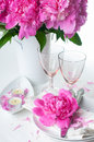 Festive table setting with pink peonies bright candles and vintage cutlery Royalty Free Stock Photography