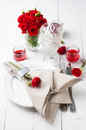 Festive table setting with red roses Royalty Free Stock Photos