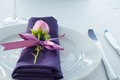 Festive table setting in the restaurant with flowers.