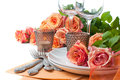Festive table setting with roses Royalty Free Stock Image