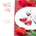 Festive table setting for valentine s day with flowers isolated on white Stock Image