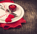 Festive table setting for valentine s day with fork knife and hearts on wooden background Royalty Free Stock Photography