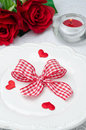Festive table setting Valentine's Day, hearts, ribbon, roses and Stock Photos