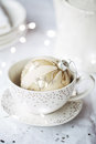 Festive teacup and saucer with christmas ornament Stock Photo
