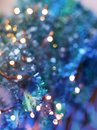 Festive texture in delicate turquoise and purple hues with colorful beautiful bokeh and multi-colored spots