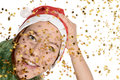 Festive woman with santa hat and golden stars Stock Photos