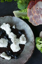 Feta cheese and  black olives on plate. Royalty Free Stock Photo