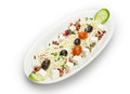 Feta cheese cut in cubes vegetables herbs and olives isoalted on white background Royalty Free Stock Photography