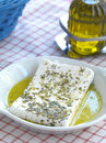 Feta cheese and olive oil a slice of traditional greek goat with virgin oregano Royalty Free Stock Images