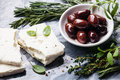 Feta cheese with olives and green herbs Royalty Free Stock Photo