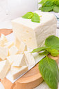 Feta cheese sliced on a wooden board Royalty Free Stock Photography