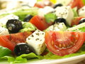 Feta and olives in salad Royalty Free Stock Photos
