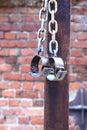 Fetters, manacles on brick background Royalty Free Stock Photo