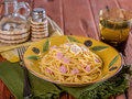 Fettuccine Alfredo in rustic setting Royalty Free Stock Photo
