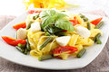 Fettuccine with green beans, mozzarella and tomato Stock Images