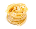Fettuccine pasta over white background Stock Image