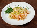 Fettuccini pasta with salmon close up Royalty Free Stock Images
