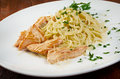 Fettuccini pasta with salmon close up Stock Image