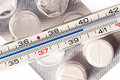 Fever thermometer and tablets Royalty Free Stock Photo
