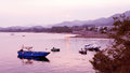 Few fishing boats in water bay at sunset Royalty Free Stock Photo