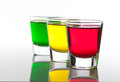 A few glasses of alcoholic drinks in red green yellow Royalty Free Stock Photo