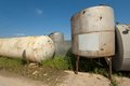 Few metal tank in row on field under blue sky Stock Images