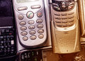 A few old mobile phones with buttons toning Royalty Free Stock Photo