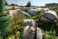 Few old tanks lying in a bush rusting industrial units Stock Photo