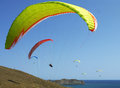 Few paragliders soar over the sea shore Stock Photography