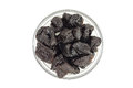 A few prunes in a glass cup on white background Royalty Free Stock Photo