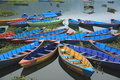 Fewa lake nepal colored pleasure boats at in pokhara Stock Photo