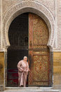 Fez morocco april unkown woman going out from mosque tra traditional door in backgroun in Stock Photo